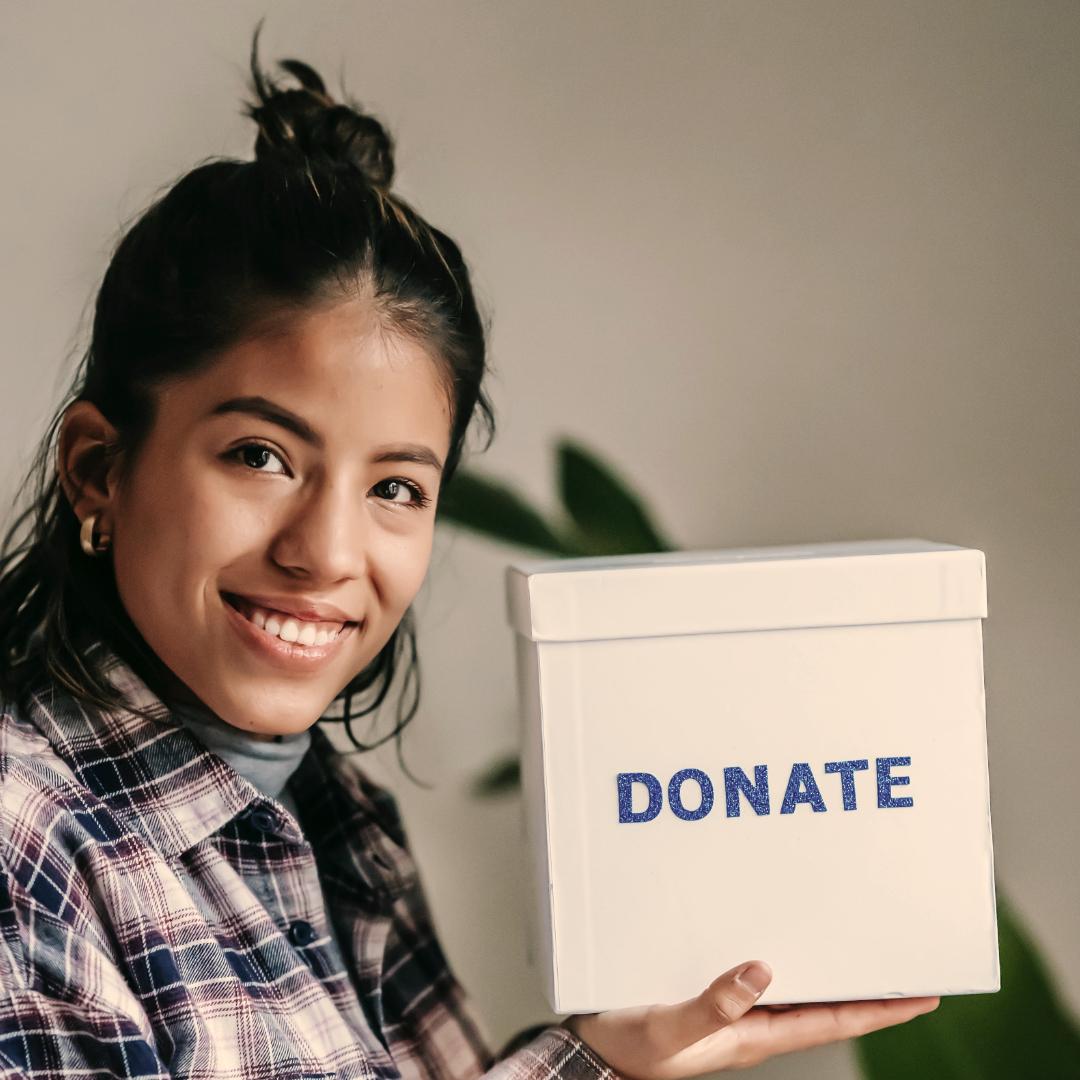 Woman carrying a box written donate
