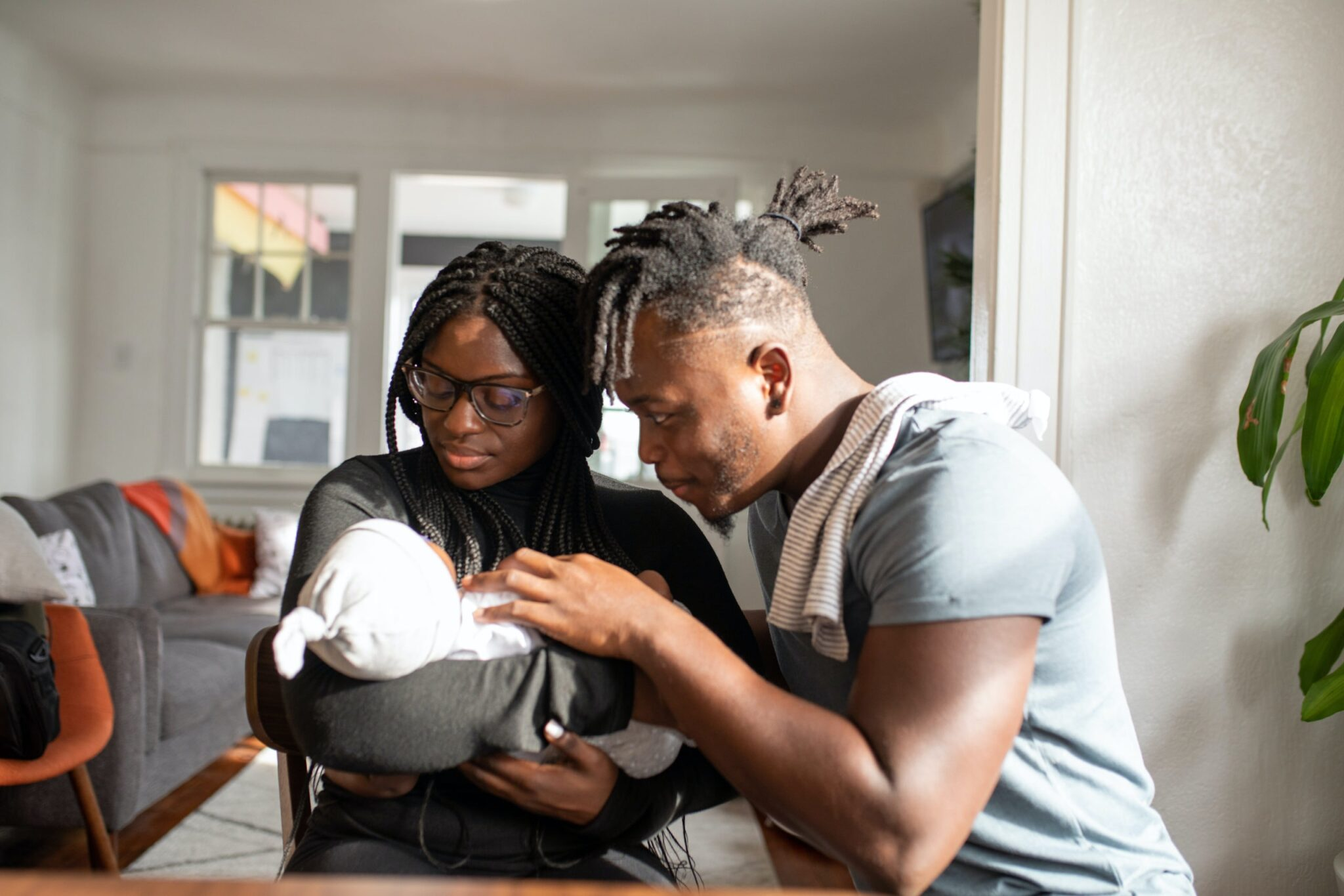 Couple holding a newborn baby